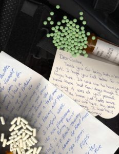 Caroline, a young adult photographer with CRPS, takes a picture of diary entries, letters, and medications that help depict CRPS